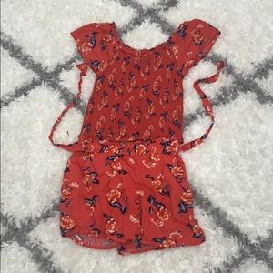 Red top and bottom with floral pattern